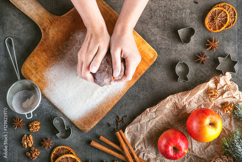 Poster Cuisine making gingerbread dough with cinnamon, spices and walnuts for Christmas, christmas baking, dough in hands, from above
