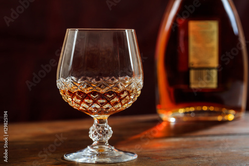 Bottle and crystal glass of cognac