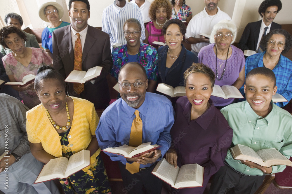 Fototapety, obrazy: Church congregation sitting on church pews with Bible portrait high angle view