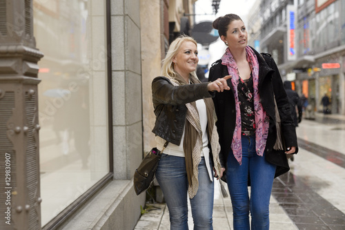 Sweden, Stockholm, Mid adult women walking down street