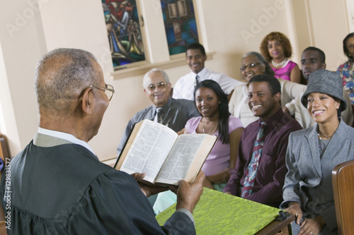 Fototapeta  Minister Giving Sermon to congregation in Church back view
