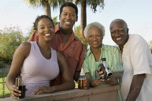 Fotografie, Obraz  Senior couple and mid-adult couple senior woman holding camcorder portrait