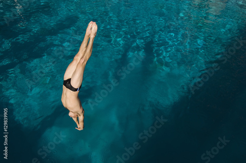 Fototapeta High angle view of a man diving into the pool