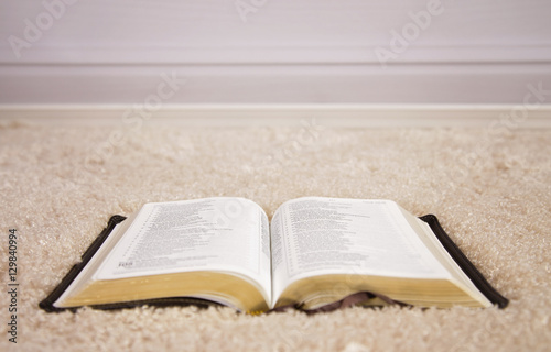 opened bible on carpet buy this stock photo and explore similar