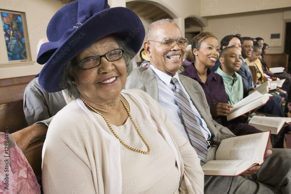 Valokuva Senior Woman in Sunday Best among congregation at Church portrait
