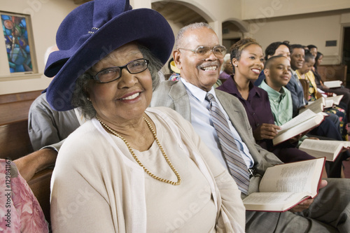 Senior Woman in Sunday Best among congregation at Church portrait Canvas Print