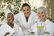 canvas print picture - Portrait of multi ethnic female friends at dining table