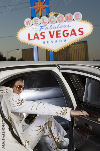 Elvis Presley impersonator stepping out from car with