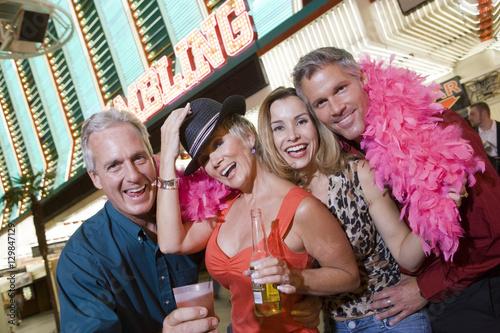 Spoed Foto op Canvas Carnaval Portrait of happy friends enjoying in front of casino