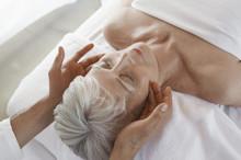 Closeup Of A Senior Woman Receiving Massage At Spa