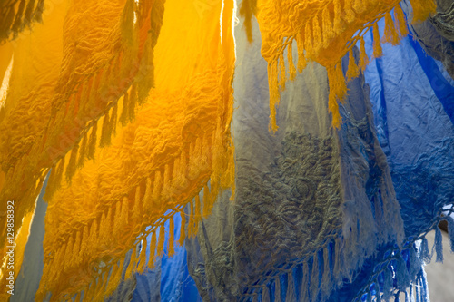 Fotobehang Stof Brightly coloured dyed fabrics hanging to dry in the dyers souk, Marrakech, Morocco, North Africa, Africa