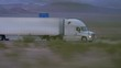 CLOSE UP: Freight semi truck driving and transporting goods on busy highway