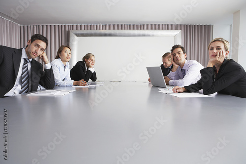 Fotografie, Obraz  Bored multiethnic business people sitting in conference room