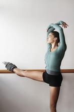 Young Female Ballet Dancer Pra...