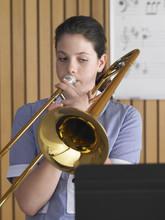 High School Girl Playing Tromb...