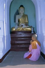 Nun And Statue Of The Buddha, Shwedagon Paya (Shwe Dagon Pagoda), Yangon (Rangoon)