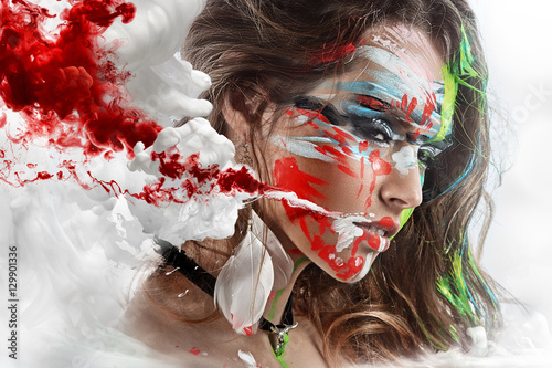 Fotografía  Halloween Painted beautiful woman face, artistic make up, body and face art, close up
