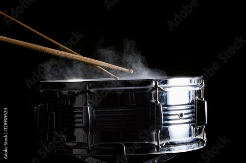 Photo Drum sticks hit on the snare drum