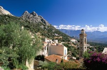 View Across Rooftops Of The Village Of Lumio, Balagne, Corsica, France