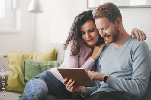 Fotografie, Obraz  Happy couple surfing on tablet at home