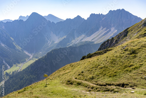Fotobehang Alpen Steep alpine mountains with forested valleys