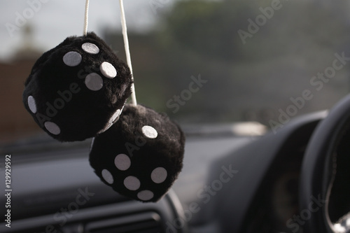 Photo  Fluffy furry dices hanging in a car
