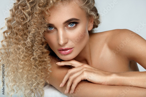 Fotografie, Obraz  Beautiful Woman Model With Blonde Curly Hair And Soft Skin