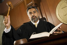 Male Judge Knocking Gavel In T...
