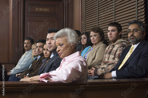 Obraz Diverse group of jurors sitting in jury box of a courtroom - fototapety do salonu