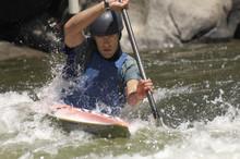 Young Man Whitewater Kayaking On Mountain River