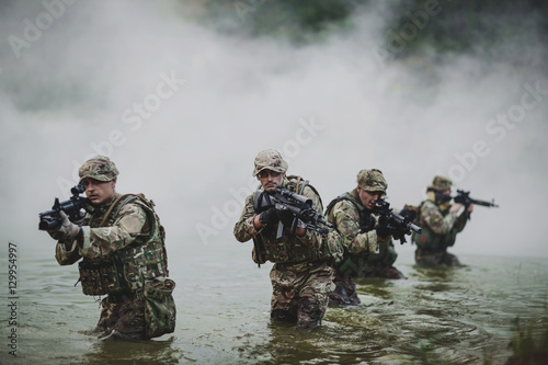 special forces soldiers with weapon take part in military maneuv Canvas Print