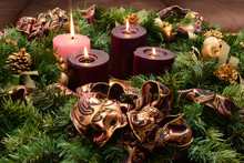 Traditional Advent Wreath On Rustic Table With Candles Glowing Warm