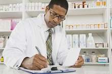 African American Male Pharmacist Working In Pharmacy