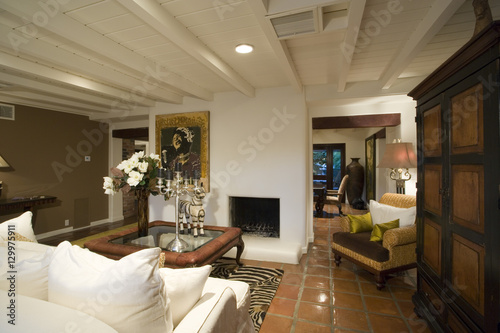 . View of an old fashioned living room in a house   Buy this stock