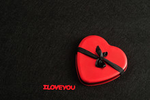 Valentines Day. A Red Heart Tied With A Black Ribbon
