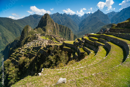 View of the Lost Incan City of Machu Picchu near Cusco, Peru. Machu Picchu is a Peruvian Historical Sanctuary. Terraces can be seen on foreground.