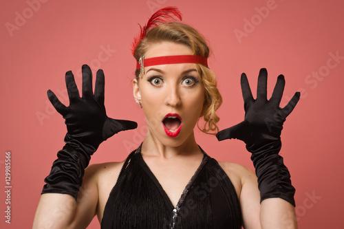 pretty actress in black retro dress with headband
