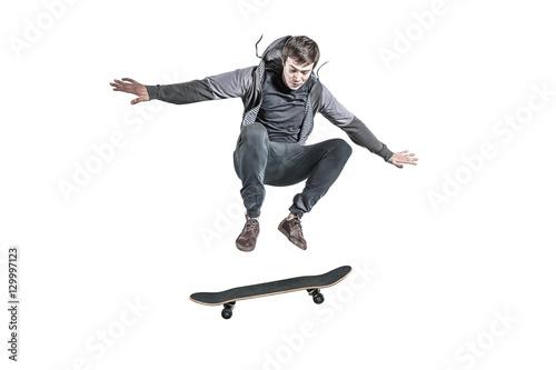 Fotografie, Obraz  Jumping skateboarder isolated