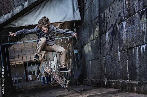 Fotografie, Obraz  Jumping skateboarder on urban background