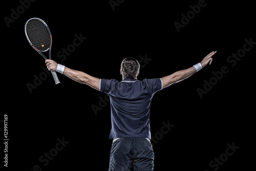 Tennis player with hands up isolated on black Tableau sur Toile