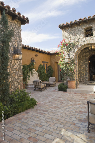 Staande foto Industrial geb. Sitting area in paved courtyard along houses