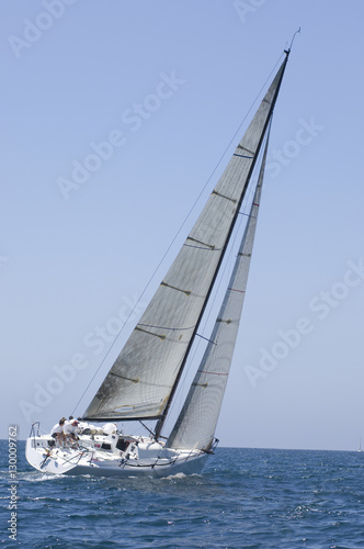 Garden Poster Sailing Sailboat racing in the blue and calm ocean against sky