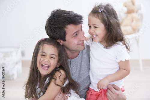 Fotografie, Obraz  Happy father with daughters spending quality time together at home