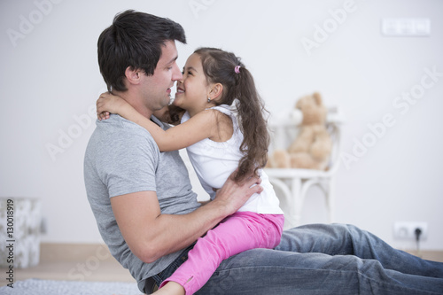 Fotografie, Obraz  Side view of father and daughter spending quality time at home
