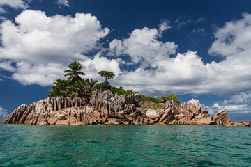 Seychelles. Desert island with rocks and palm trees.