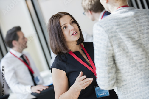 Fotografia, Obraz  Businesswomen talking during coffee break at convention center