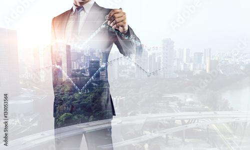 Fototapeta His business growth and progress . Mixed media obraz na płótnie