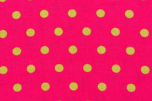 Yellow Dot Over Pink Polka Dot Fabric Background And Texture.