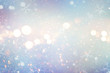 Christmas glow winter background. Defocused snow background with blinking stars and snowflakes