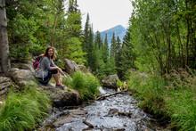 Female Hiker Sitting Near Tynd...